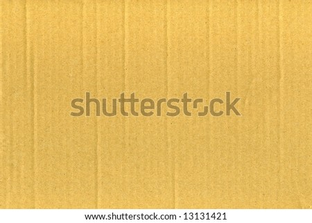 closeup of a brown cardboard surface background - stock photo