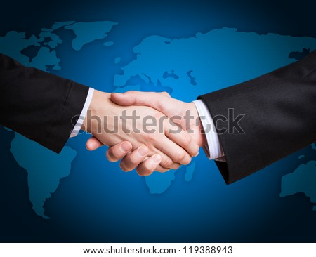 Closeup of a business hand shake between two colleagues - stock photo