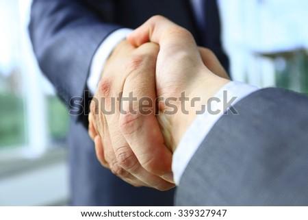 Closeup of a business handshake - stock photo