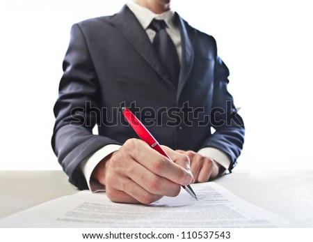Closeup of a businessman's had signing a document - stock photo