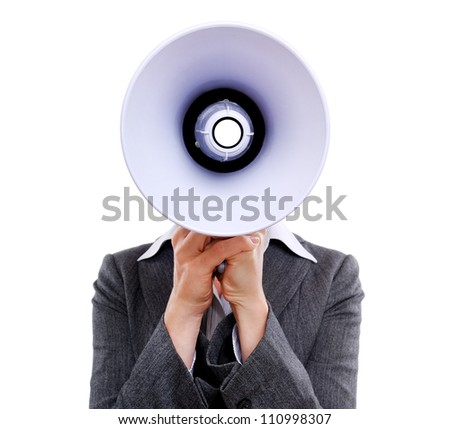 Closeup of a businesswoman hiding face behind  the  megaphone against a white background - stock photo