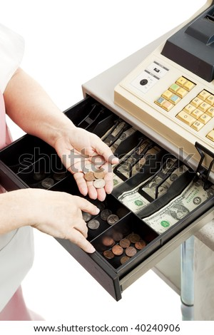 Closeup of a cashier's hands making change in a cash register drawer.  Vertical view, white background. - stock photo