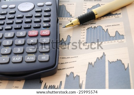 Closeup of a chart with a pen and calculator - stock photo