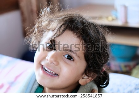 Closeup of a cheerful little girl  - stock photo