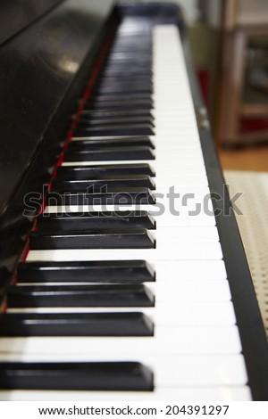 Closeup of a classical piano - stock photo