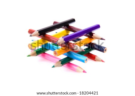 Closeup of a collection of bright color pencils forming a building. Isolated on white. - stock photo