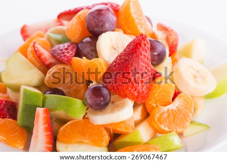 Closeup of a colorful fruit salad on a plate - stock photo