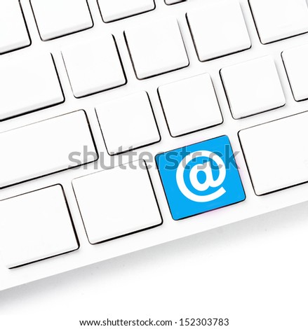 Closeup of a computer keyboard with blank keys and At sign , white keyboard isolated on white background - stock photo
