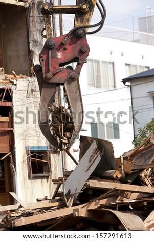 Closeup of a crane picking broken wooden scrap - stock photo