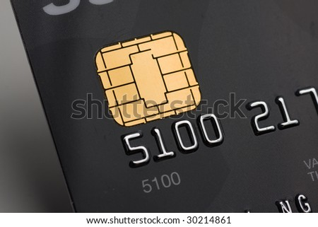 Closeup of a credit card with a gold chip - stock photo