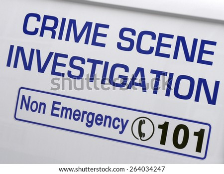 Closeup of a 'Crime Scene Investigation' sign on police van - stock photo