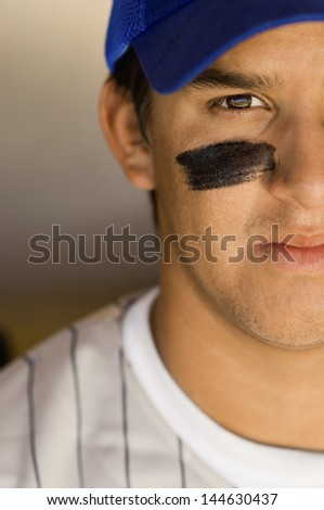 Closeup of a cropped confident baseball player - stock photo