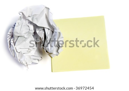 Closeup of a crumpled paper and note isolated on white background - stock photo