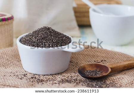 Closeup of a cup of chia seeds - stock photo