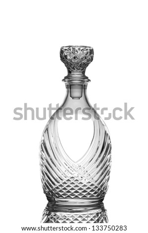 Closeup of a cut crystal whiskey decanter isolated on white with reflection. - stock photo