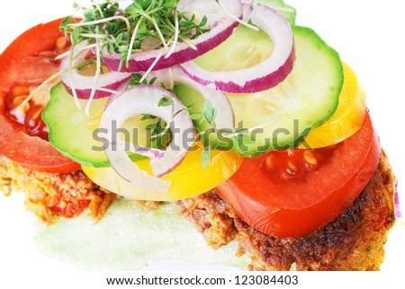 closeup of a danish open faced sandwich or smoerbroed with carrot patties, otherwise known as vegetarian frikadelles. - stock photo