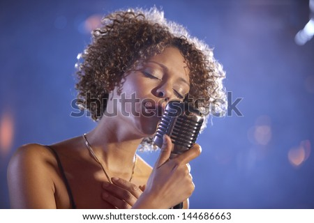 Closeup of a female jazz singer on stage - stock photo