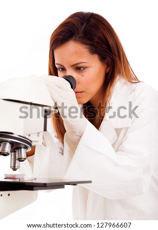 Closeup of a female scientist looking through microscope, isolated on white - stock photo