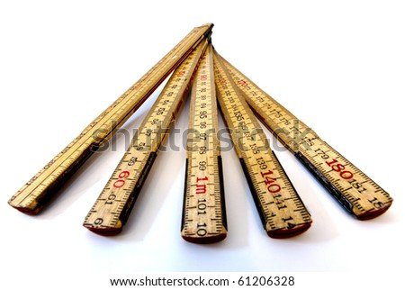 closeup of a folding wooden ruler using the metric system - stock photo
