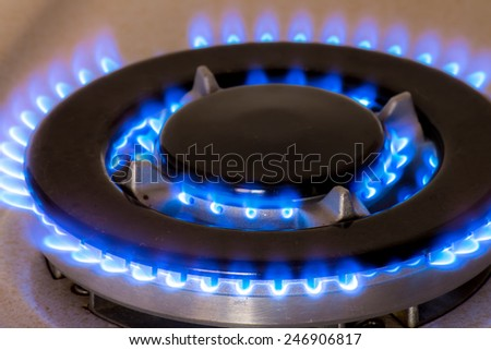 Closeup of a gas burner of a stove - stock photo