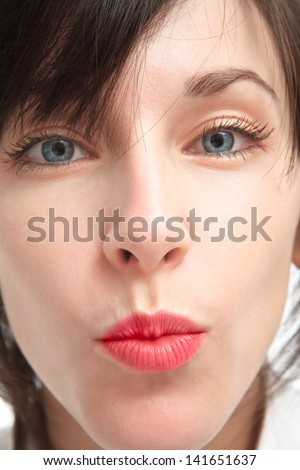 closeup of a girl's face - a kiss - sharpness of lips - shallow depth of field - stock photo