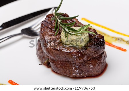Closeup of a gourmet dinner plate with a steak, vegetables and potatoes - stock photo