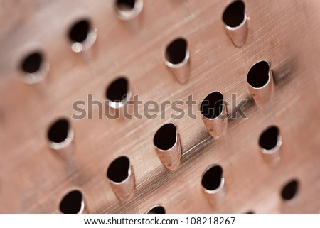 Closeup of a grater texture with shallow depth of field - stock photo