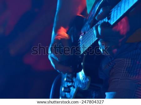 Closeup of a guitar player - stock photo