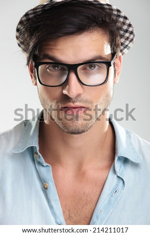 Closeup of a handsome man wearing glasses and looking at the camera - stock photo