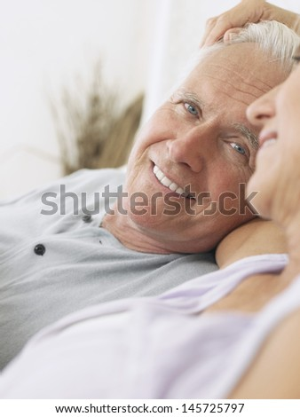 Closeup of a happy and romantic middle aged couple  - stock photo