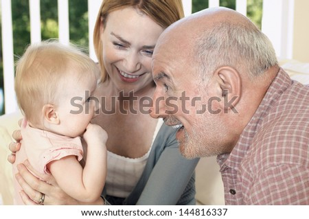 Closeup of a happy grandparent with daughter and granddaughter - stock photo