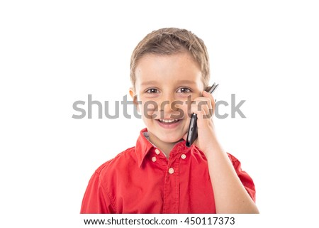 Closeup of a happy little boy speaking on his smartphone over white background  - stock photo
