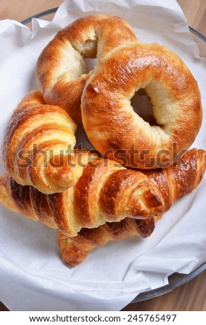 Closeup of a heap of bagels and croissants - stock photo
