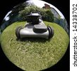 Closeup of a lawnmower in a backyard with fish eye lens - stock photo