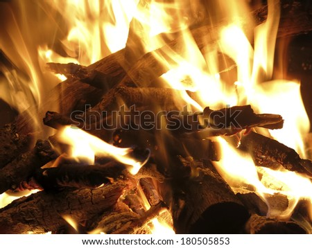 Closeup of a log burning camp fire for background - stock photo