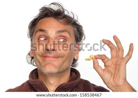 closeup of a man crazy for potato chips over white - stock photo