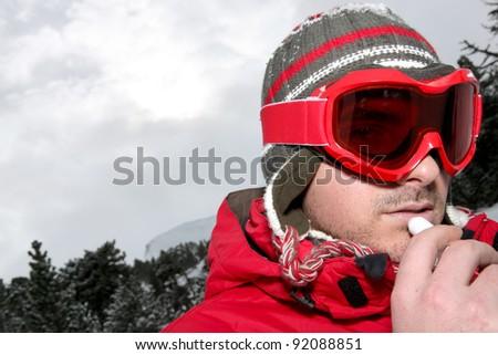 Closeup of a man in ski goggles - stock photo