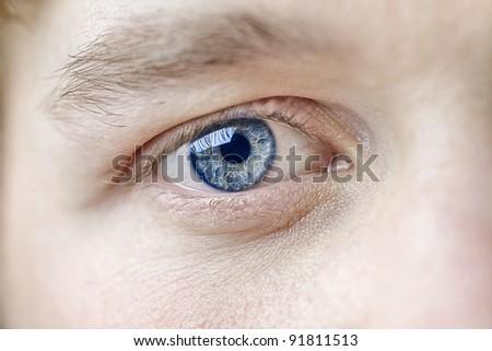 Closeup of a man's eye - stock photo