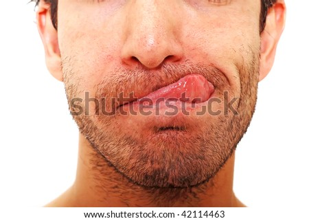 Closeup of a man's face with his tongue out - stock photo