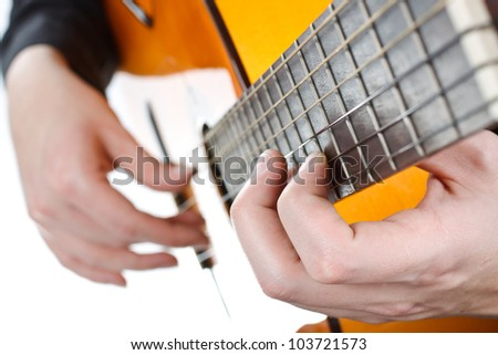Closeup of a man's hands playing the guitar - isolated on white - stock photo