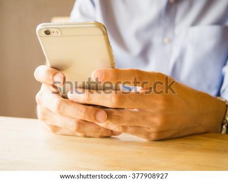 Closeup of a man using smartphone - stock photo