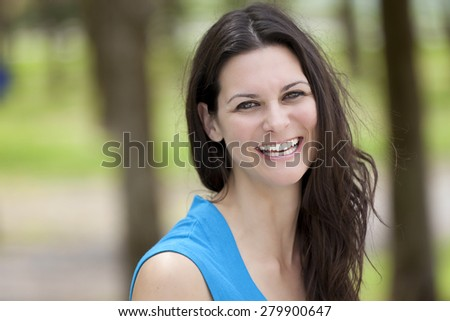 Closeup Of A Mature Woman Smiling At The Camera - stock photo