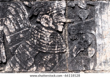 Closeup of a Mayan carving in a temple in Chichen Itza, in Mexico - stock photo