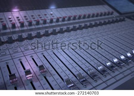 closeup of a mixing desk - stock photo