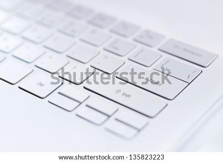 Closeup of a modern ultra thin keyboard with a big return key - stock photo