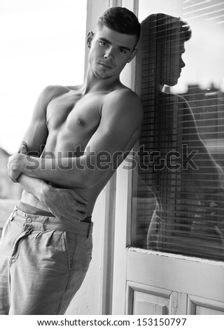 Closeup of a muscular handsome man - stock photo