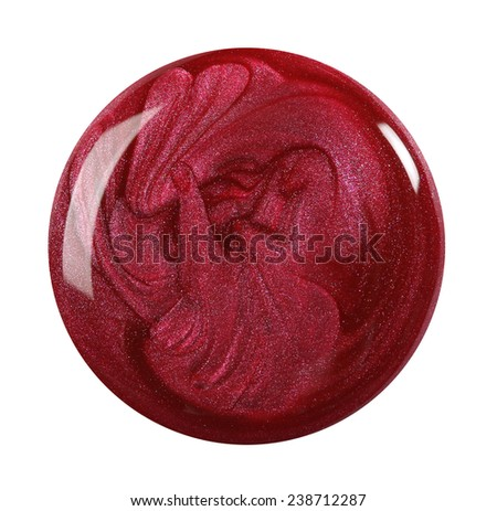 Closeup of a nail polish droplet isolated on white - stock photo