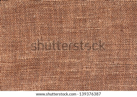 Closeup of a natural burlap texture as the background - top view - stock photo