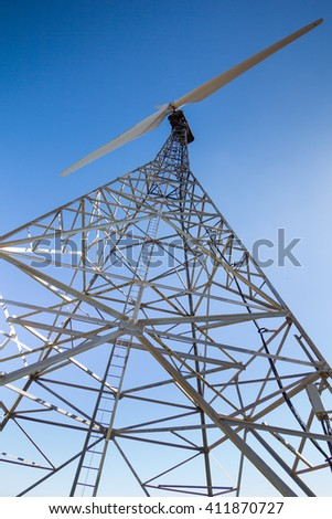 closeup of a old wind turbine for renewable electric energy production, in Algeciras, Andalusia, Spain. - stock photo