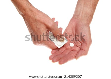 Closeup of a pair of hands dispensing a tablet from a blister pack isolated against white - stock photo